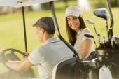Couple at golf cart — Stock Photo