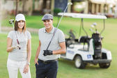 Couple near golf cart — Stock Photo