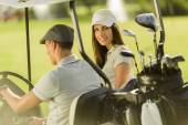 Couple at golf cart — Stock Photo