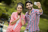 Couple taking photo with mobile phone — Foto Stock