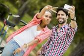 Couple taking photo with mobile phone — Stock Photo