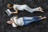 Women relaxing on the carpet — Stock Photo