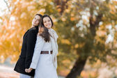 Young couple in the autumn park — Stock Photo