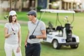 Young couple at golf cart — Stock Photo