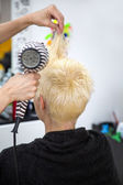 Woman at hairdresser — Stock Photo