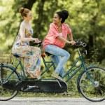 Women riding on bicycle — Stock Photo #53638513