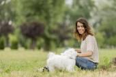 Woman with a maltese dog — Zdjęcie stockowe