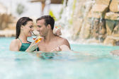 Young couple in the pool — Stock Photo