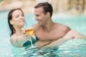 Young couple in the pool — Foto de Stock