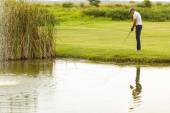 Young man playing golf — Stock Photo