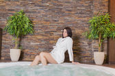 Young woman relaxing in the hot tub — Stock Photo