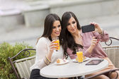 Young women in the cafe — Stock Photo