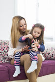 Mother and daughter in the room — Stock Photo