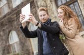 Couple taking photo with tablet — Stock Photo