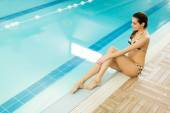Young woman by the pool — Stock Photo