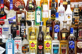 Alcohol bottles in bar — Stock Photo