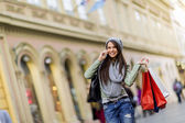 Young woman in shopping — Stock Photo