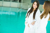 Young women by the pool — Stock Photo