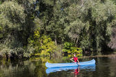 Young man in canoe — Stock Photo