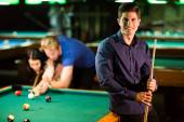 Young people playing pool — Stock Photo