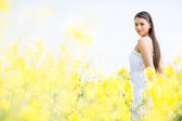 Young woman in the spring field — Stock Photo