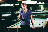 Young man playing pool — Stock Photo