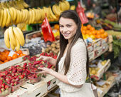 Young woman on the market — Stock Photo