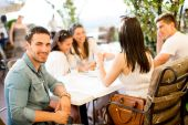 Young people by the table — Stock Photo