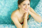 Young woman in the swimming pool — Stock Photo