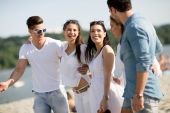 Young people on the beach — Stock Photo