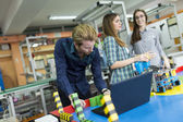 Young people in the classroom — Stock Photo