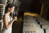 Young woman in the wine cellar — Stock Photo