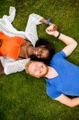 Multiracial couple in the park — Stock Photo