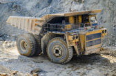 Truck in open pit mine — Stock Photo