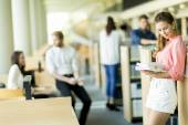 Young woman in the library — Stock Photo
