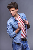 Male fashion model with modern haircut — Stock Photo