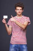 Man showing empty blank paper card sign — Stock Photo