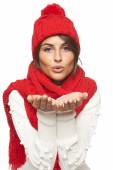 Winter woman blowing a kiss — Stock Photo