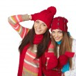 Two winter girls showing blank cards — Stock Photo #57309271
