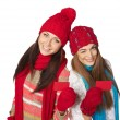 Two girls in winter clothing showing credit cards — Stock Photo #58334433