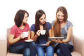 Three girls friends using tablet — Foto de Stock