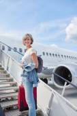 Woman with backpack going on boarding — Stock Photo