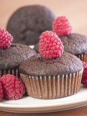 Brown muffins with raspberry — Stock Photo