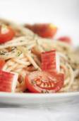 Pasta with crab and cherry tomatoes close up — Stock Photo