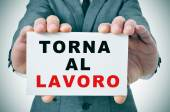 Torna al lavoro, back to work in italian — Stock Photo