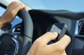Man using a smartphone while driving a car — Stock Photo