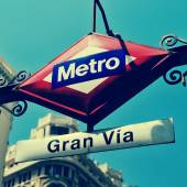 Sign of Gran Via metro station in Madrid, Spain, with a retro ef — Stock Photo