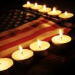 Flag of the United States and lighted candles — Stock Photo #52469463