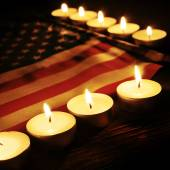 Flag of the United States and lighted candles — Stock Photo
