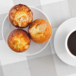Magdalenas, typical spanish plain muffins, and coffee — Stock Photo #52747733